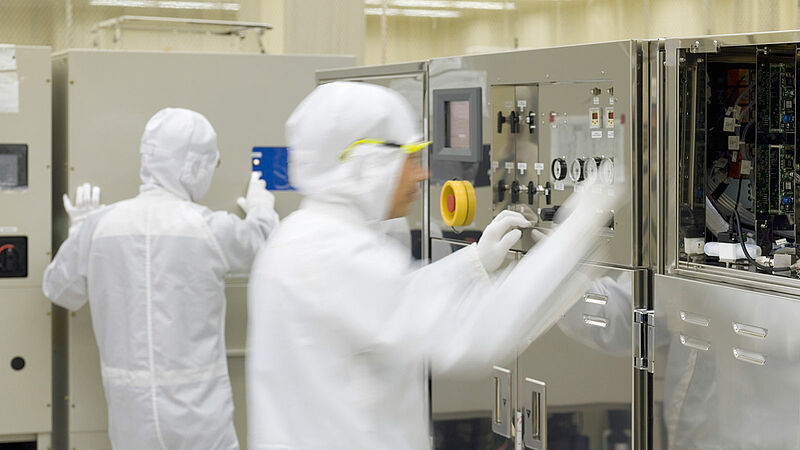 Two people working in a clean room