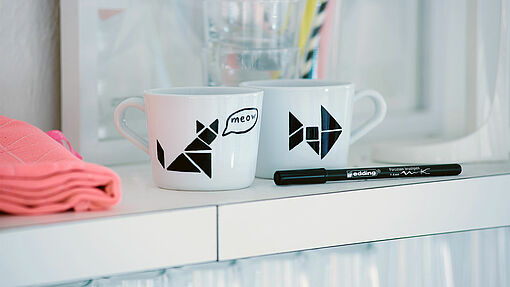 Painting cups in black and white