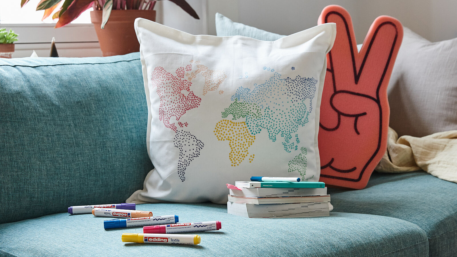 DIY world map cushion made with edding textile markers and pens