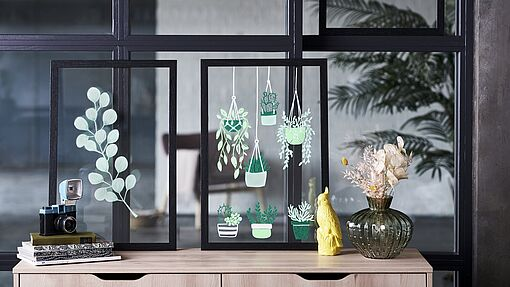 Hanging plant design on glass