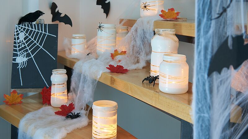 Spooky glass jar lanterns