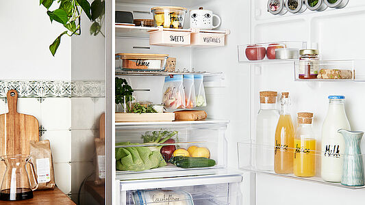 organised fridge with clearly labeled drawers and food containers