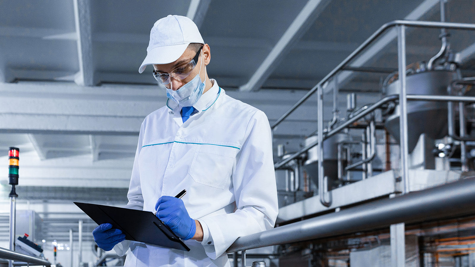 Man making notes in a sterile production