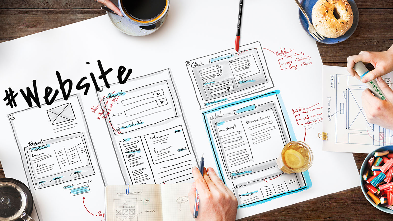 Website wireframes being drawn on paper